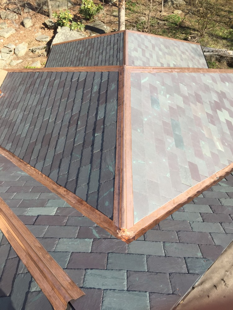 Photo By Bryhn Design/Build. Slate & Copper Roof