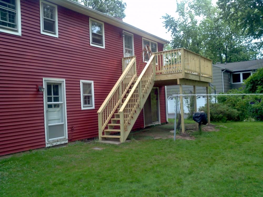 Photo By Vista Home Improvement. Decking