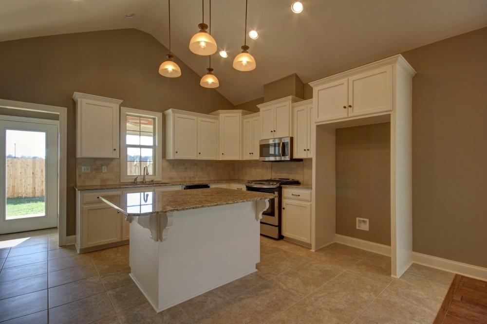 Photo By Manuel Builders. Nadia Floor Plan With Heritage Elevation