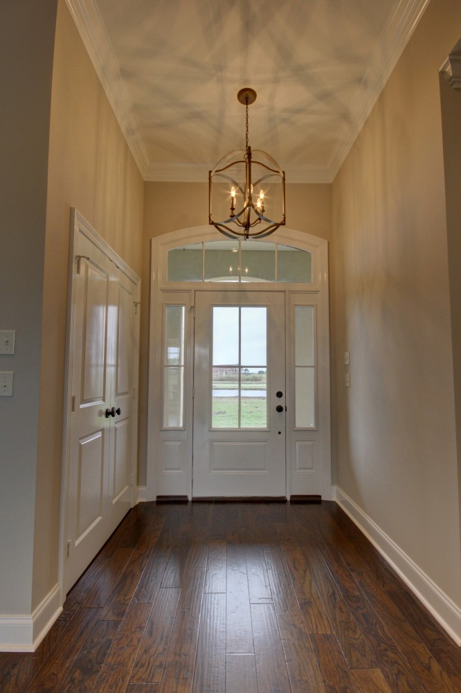 Photo By Manuel Builders. Customized Delhomme Floor Plan