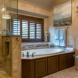 Photo by Curb Appeal Renovations. Bright Traditional Master Bath - thumbnail