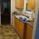Photo by Acclaim Renovations & Design. Sink Wall - Before & After - thumbnail