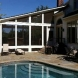 Photo by American Exteriors & Masonry. Screened Room, Patio, and Fireplace in Paeonian Springs, VA - thumbnail