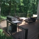 Photo by TrueSon Exteriors. Composite Deck - thumbnail