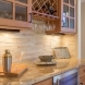 Photo by Quality Renovations & Home Services, LLC. Kitchen & Living Room Remodel - thumbnail