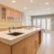 Photo by Reborn Cabinets, Inc.. Modern Kitchen Remodel - thumbnail