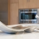 Photo by Reborn Cabinets, Inc.. Modern Kitchen Remodel - thumbnail