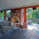 Photo by Mosby Building Arts. Outdoor Fireplace and Deck - thumbnail