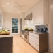 Photo by Wentworth, Inc.. Open floor plan kitchen & family room remodel - thumbnail