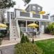 Photo by Boardwalk Builders. Bed & Breakfast Back Porch - thumbnail