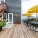 Photo by Boardwalk Builders. Bed & Breakfast Back Porch - thumbnail