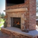 Photo by Mosby Building Arts. Outdoor Fireplace and Covered Patio - thumbnail