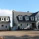 Photo by Care Free Homes Inc.. Maibec Cedar Siding, CertainTeed Designer Roofing, AZEK Decking in Marion, MA - thumbnail