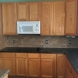 Photo by Home Building Solutions LLC. Kitchen Counter Top & Back Splash - thumbnail