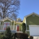 Photo by Nelson Exteriors. Bright exterior paint job - thumbnail