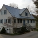 Photo by Classic Metal Roofs, LLC. Cape style home/ Oxford slate rock - thumbnail