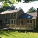 Photo by Beantown Home Improvements. Owens Corning Roof in Driftwood - thumbnail