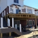 Photo by Autumnwood Construction. Cap composite deck - thumbnail