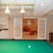 Photo by Owens Corning Basements of New England / Lux Renovations. Cape Cod Basement Renovation - thumbnail