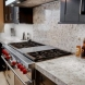 Photo by Premier Kitchen and Bath. Kitchen and Fireplace Remodel - thumbnail