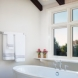 Photo by HC Remodel & Design. Stunning White Total Bath Makeover - thumbnail