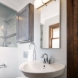 Photo by HC Remodel & Design. Space Saving Small Bath Transformation - thumbnail