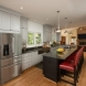 Photo by Tabor Design Build. Three Story Rear Addition & Kitchen Remodel - thumbnail