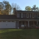 Photo by Burke Building & Remodeling LLC. New siding, soffit, fascia, gutters and screened porch - thumbnail