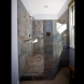 Photo by Golden Rule Creative Remodel. Sky and Stone Bath - thumbnail
