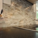 Photo by New England Design & Construction. First floor living and kitchen area - thumbnail