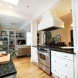 Photo by Real Remodels. Living Room and Bathroom Remodel - thumbnail