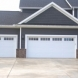 Photo by Unified Window Systems Inc. . Garage Doors - thumbnail