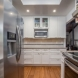 Photo by Talmadge Construction, Inc. Small White Contemporary Kitchen Remodel - thumbnail