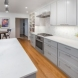 Photo by Talmadge Construction, Inc. Large White Contemporary Kitchen Remodel - thumbnail