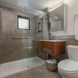Photo by Talmadge Construction, Inc. Small Modern Bathroom with Floating Vanity - thumbnail