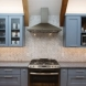 Photo by Talmadge Construction, Inc. Large Blue Contemporary Kitchen w/ Vaulted Ceilings - thumbnail