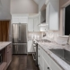 Photo by Talmadge Construction, Inc. Contemporary Upstairs Kitchen Remodel - thumbnail