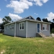 Photo by Texas Home Exteriors. LP SmartSide siding job Conroe Texas by Texas Home Exteriors.  - thumbnail