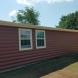 Photo by ABC Seamless of North East Oklahoma. Cinnamon Log Siding - thumbnail