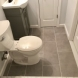 Photo by All Renovations. Basement Finish with Custom Bathroom - thumbnail