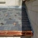 Photo by BRAX Roofing. New seamless half round copper gutters and snow guards.  - thumbnail