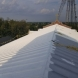 Photo by BRAX Roofing. Silicone roof coating  - thumbnail