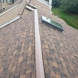 Photo by BRAX Roofing. Owens corning Duration shingle roof replacement with velux skylights - thumbnail