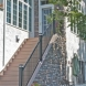Photo by EBY Exteriors Inc.. Rivera Stairs, Railing & Stone - thumbnail