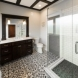Photo by DreamMaker of Greater Grand Rapids. Sleek Bathroom Remodel - thumbnail