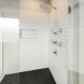 Photo by DreamMaker of Greater Grand Rapids. Sleek Bathroom Remodel - thumbnail