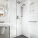Photo by HC Remodel & Design. Black and White Guest Bath Makeover - thumbnail