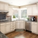 Photo by HC Remodel & Design. Warm Kitchen Facelift - thumbnail