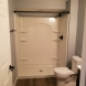 Photo by Russell Room Remodelers. Basement Bathroom - thumbnail