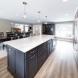 Photo by DreamMaker of Greater Grand Rapids. Sleek Main Floor Remodel - thumbnail